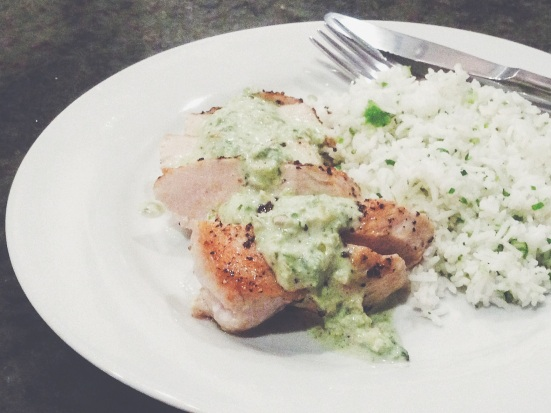 Pan Fried Chicken Breast with Poblano Cream Sauce served with Basmati Rice with Chopped Scallion.